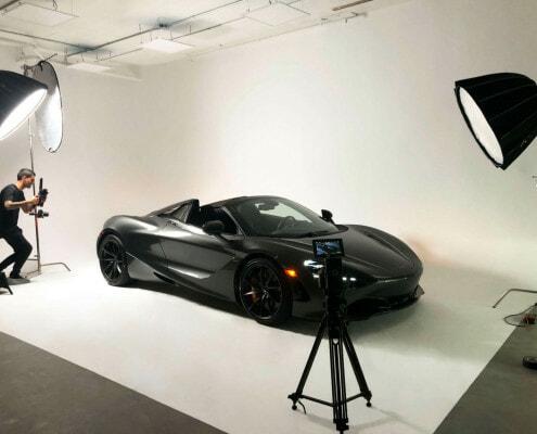 McLaren Video Shoot man shooting car staged on cyc wall