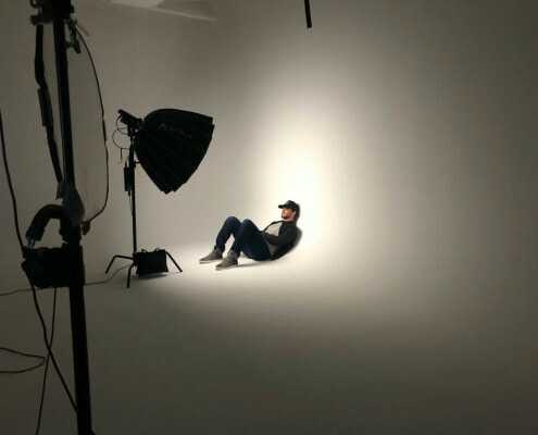 Male model leaning up against Cyclorama wall